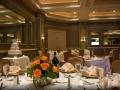 Tables set with Orange Flower Centerpieces