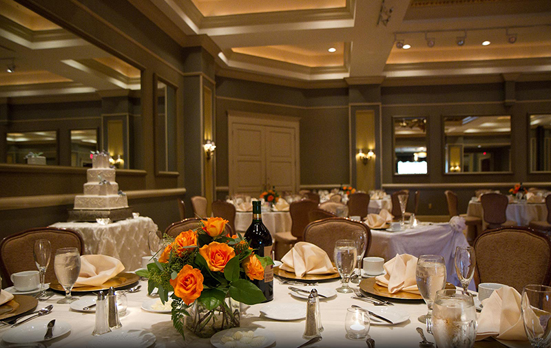 Tables set with Orange Flower Centerpieces