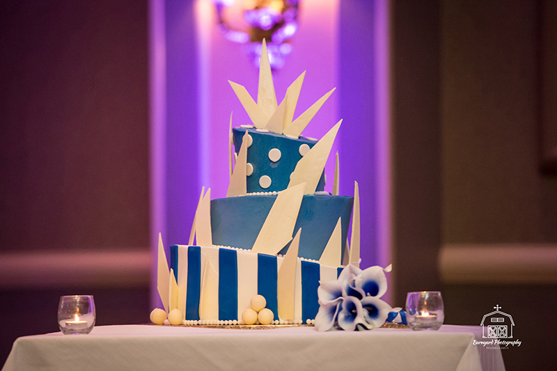 Blue-themed angled cake