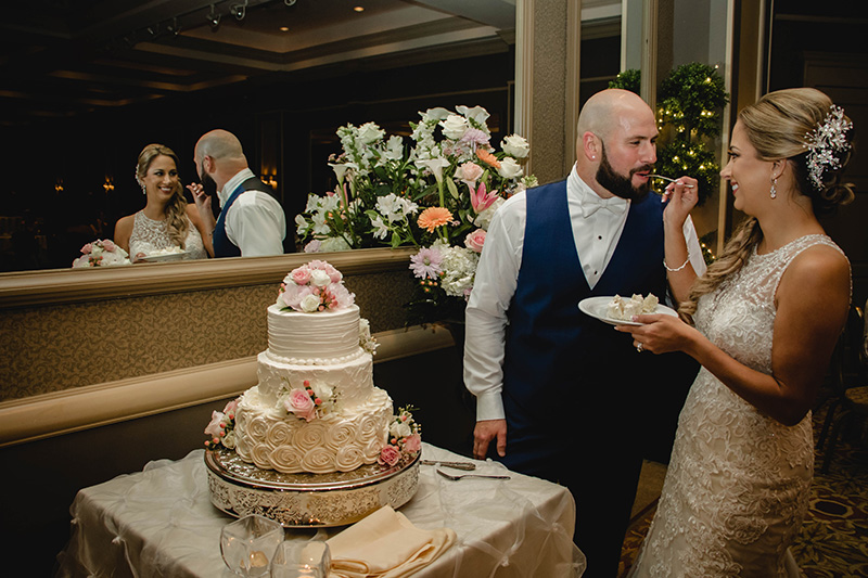 Bride & Groom Taste the Cake