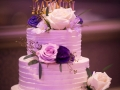 White cake, purple flowers