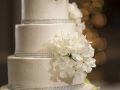 White cake with Floral Accent and Silver Band