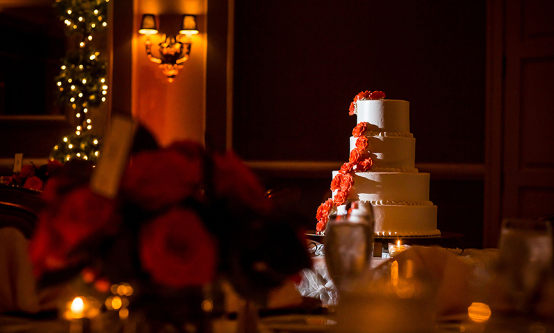 cake-in-ballroom-orange-flowers-cakes
